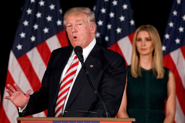 Ivanka Trump listens as her father, Republican presidential nominee Donald Trump, delivers a policy speech on child care Tuesday in Aston, Penn.