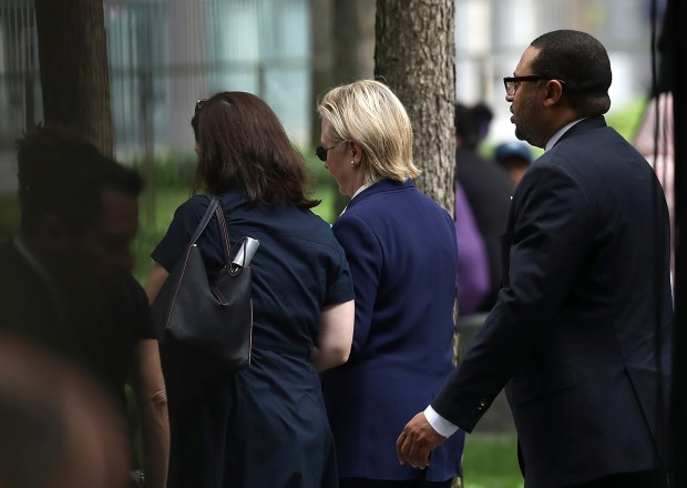 Democratic presidential nominee Hillary Clinton leaves Sunday's Sept. 11 ceremony at the National September 11 Memorial & Museum.