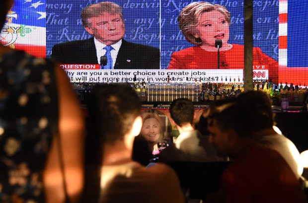 Supporters of Hillary Clinton watch the first presidential debate Monday night at a restaurant in West Hollywood, Calif.