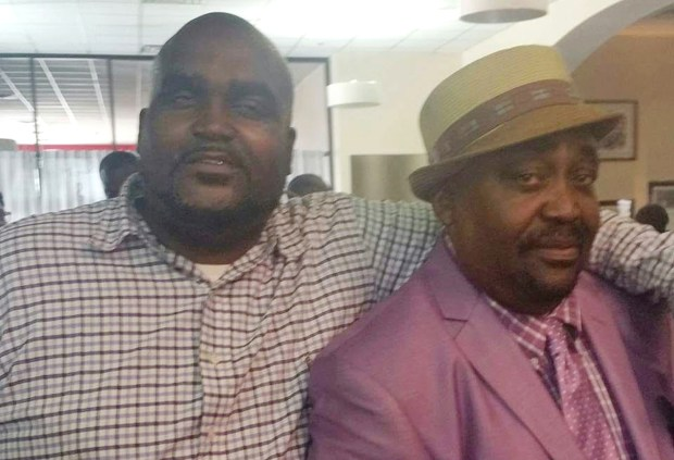 This photo provided by the Parks & Crump, LLC shows Terence Crutcher, left, with his father, Joey Crutcher.