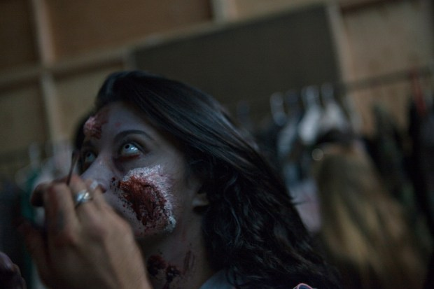 Actor Eve Delao gets the final touches done on her makeup at The Asylum Haunted House in Denver Saturday, October 19, 2013.