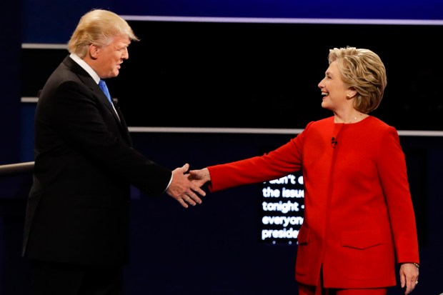 Republican presidential nominee Donald Trump and Democratic presidential nominee Hillary Clinton shake hands before Monday night's debate at Hofstra University.