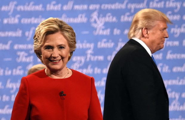 Hillary Clinton and Donald Trump leave the stage after Mondat night's presidential debate at Hofstra University.