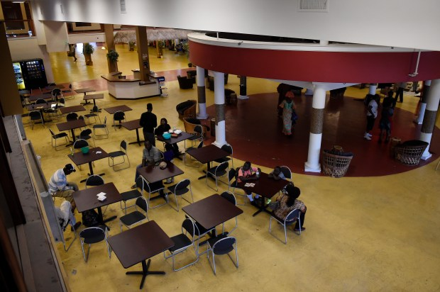 Patrons sit in the food court at Afrikmall in Aurora, Colorado on September 6, 2016. The Afrikmall in Aurora has finally opened a portion of the space. The dual level space has single tenants on the bottom floor and an unused upper level that the Aurora Cultural Arts District is possibly going to buy as studio space for resident artists.