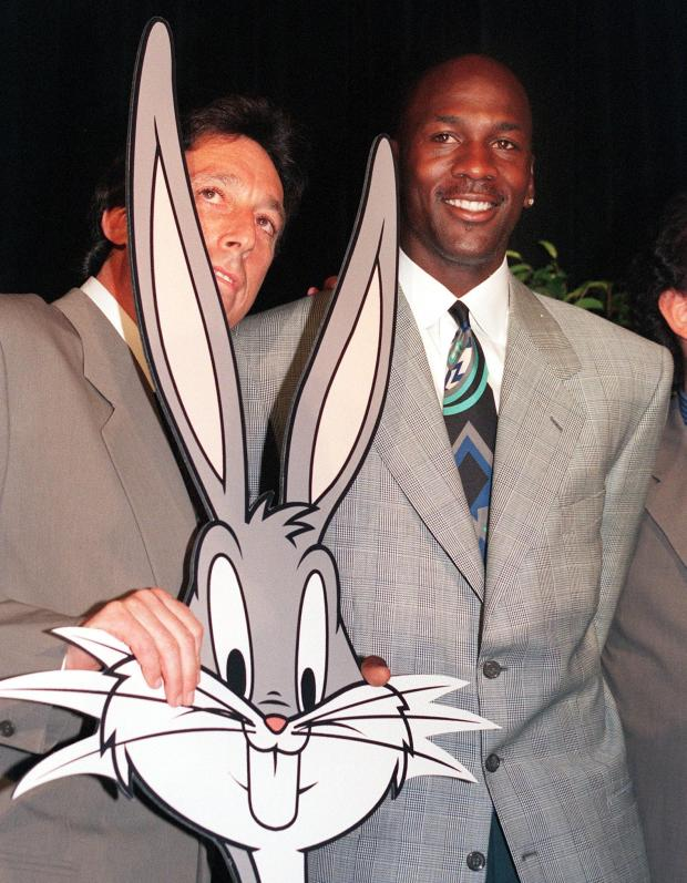 """American basketball star Michael Jordan poses with a cutout of Bugs Bunny June 20, 1995 as they announce Jordan's film debut in an original live-action/animation comedy """"Space Jam."""""""