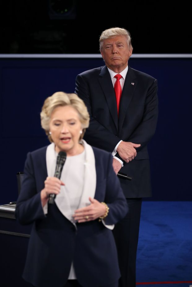 Republican presidential candidate Donald Trump listens to Democratic presidential candidate Hillary Clinton during the second presidential debate at Washington University in St. Louis, Missouri, on October 9, 2016.
