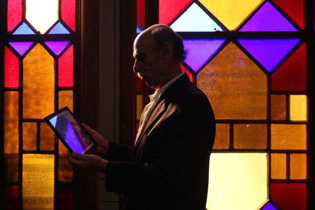 Randy Rubin reminisces over historic family photos in the old Temple on Thursday afternoon. He explained that all of the figures are deceased except for his mother at age 93. Temple Aaron in Trinidad Colorado is closing down after 132 years of service.