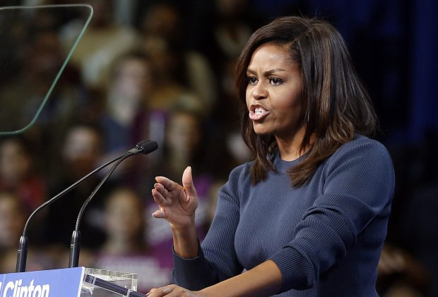 First lady Michelle Obama speaks during a campaign rally for Democratic presidential candidate Hillary Clinton Thursday, Oct. 13, 2016, in Manchester, N.H.