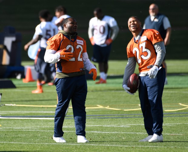 Denver Broncos running backs C.J. Anderson (22) and Devontae Booker (23)