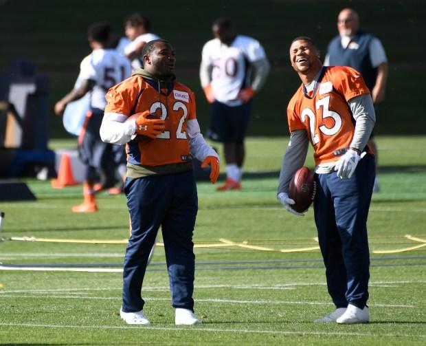 Denver Broncos running backs C.J. Anderson (22) and Devontae Booker (23)