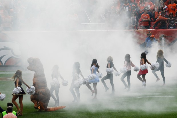 Denver Broncos cheerleaders, dressed in Halloween costumes, wait for the team to take the field during the first quarter on Sunday, Oct. 30, 2016. The Denver Broncos hosted the San Diego Chargers.