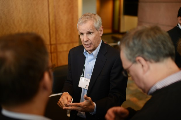Charlie Ergen, center, answers questions during the 2013 annual meeting of shareholders at DISH network's headquarters in Englewood May 2, 2013.