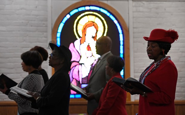 Members of the church sing during worship service at Campbell Chapel AME Church on October 23, 2016 in Denver, Colorado. Campbell Chapel is a politically engaged church; it recently hosted an election forum. Next Sunday, the congregation is invited to bring their ballots in to pray over them and then put them in the ballot box.