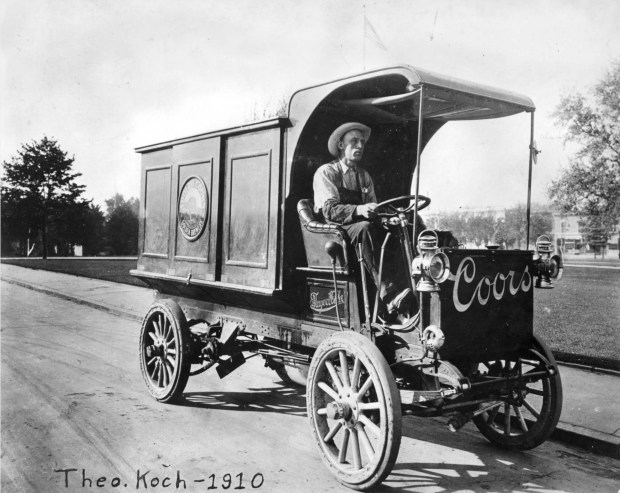 In this 1910 photo, Theo Koch drives an Adolph Coors Golden Brewery delivery truck, in Golden, Jefferson County.