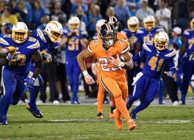 Denver Broncos running back Devontae Booker (23) picks up a big gain