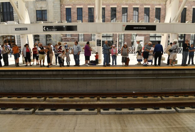 Riders wait to get on the University of Colorado A-Line from Union Station to Denver International Airport, April 22, 2016. The line is 23 miles with 8 stations along the way.