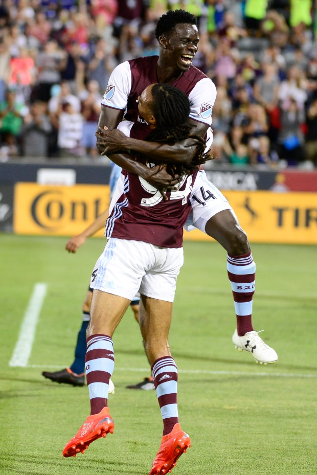 Dominique Badji celebrates his goal with winger Marlon Hairston