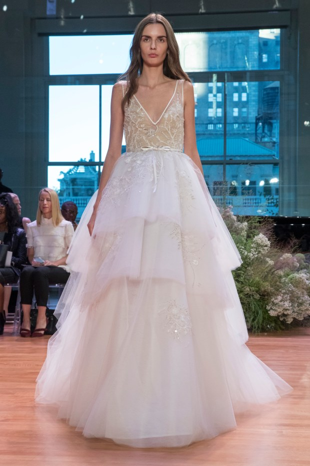 In this Friday, Oct. 7, 2016 photo, the Monique Lhuillier bridal collection is modeled during bridal fashion week in New York.