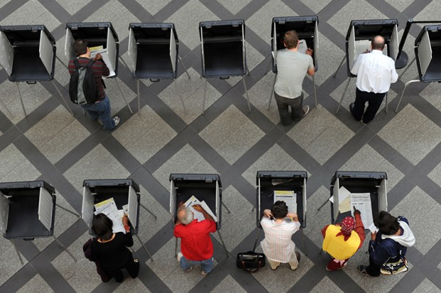 Denver residents cast their votes at the Wellington E. Webb Municipal Building.