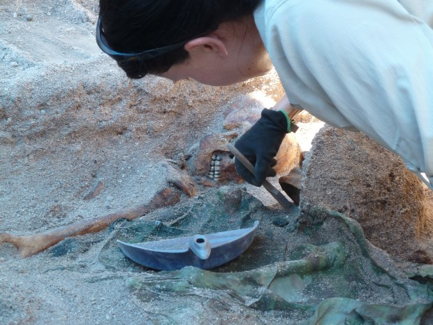 Lead archaeologist Kristen N. Baker of History Flight, Inc., carefully exposes the remains of Medal of Honor recipient, First Lt. Alexander Bonnyman, Jr.