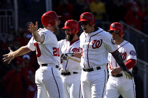 Jose Lobaton (59) of the Washington Nationals celebrates with teammates