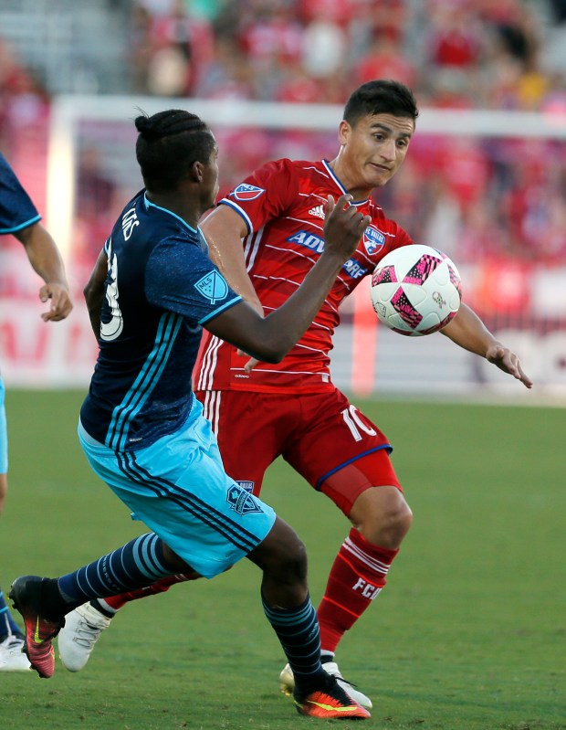Seattle Sounders defender Joevin Jones (33) and FC Dallas midfielder Mauro Diaz compete for control of the ball