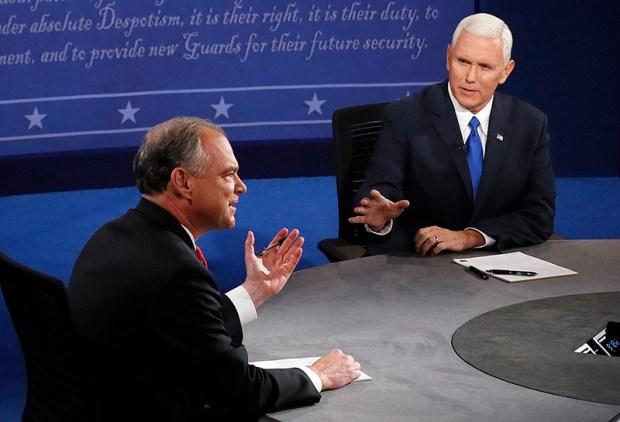 Democratic vice presidential nominee Tim Kaine, left, and Republican vice presidential nominee Mike Pence debate during Tuesday night's debate in Farmville, Va.