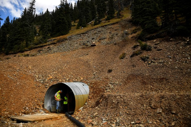 Christoph Goss, mining engineer with Deere & Ault Consultants, INC. and EPA on-scene coordinator Joyel Dhieux work in a mine opening of the Red and Bonita mine above Silverton on Sept. 27, 2016.  that continues to discharge 300 gallons per minute of toxic acid waste into the headwaters of the Animal River.