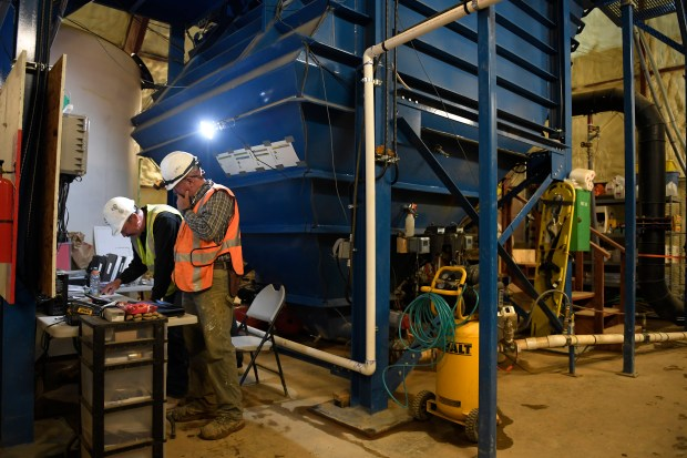 Gladstone interim water treatment plant site manager Mark Lawson and operator Jim Lancaster near the clarifier used to remove solids and treat discharge water from the Gold King mine above Silverton, CO September 27, 2016.