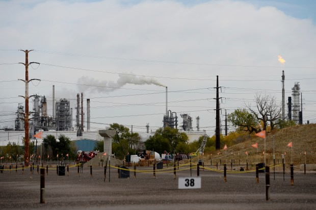 A flame shoots out of the top of stack as excess gasses are burned at Suncor Refinery