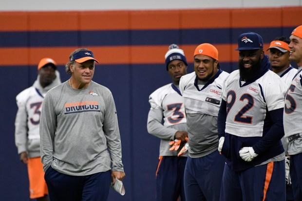 Denver Broncos interim head coach Joe DeCamillis chats with the team