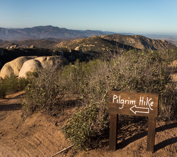 A sign marks the way to the 3.5-mile Pilgrim Hike at Rancho La Puerta in Tecate, Mexico. The Baja California spa offers at least two guided hikes each morning. MUST CREDIT: Photo by Dina Mishev for The Washington Post.