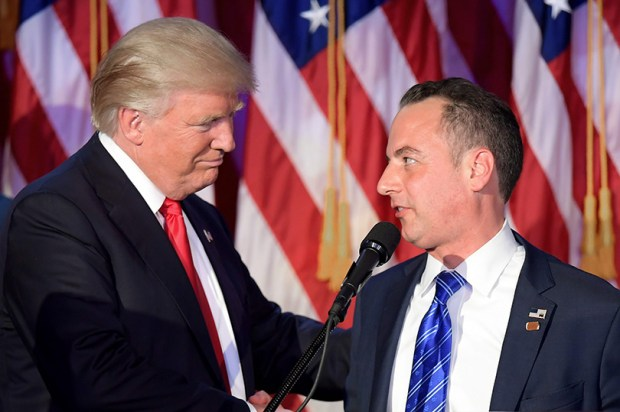 Reince Priebus, chairman of the Republican National Committee, shakes hands with President-elect Donald Trump early Wednesday morning in New York.