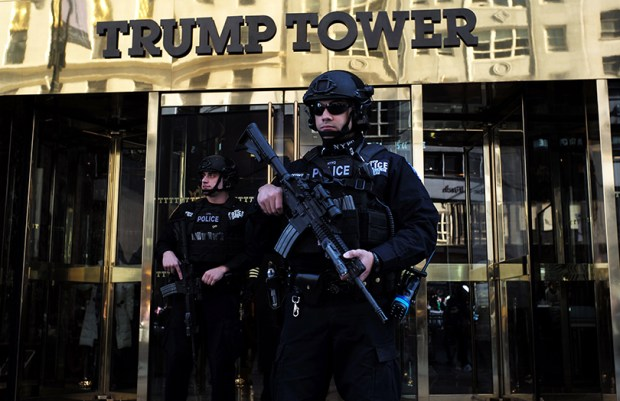 Police officers guard the main entrance of  Trump Tower last month in New York City.