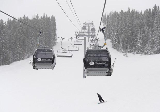 A lone snowboarder cruises a wide-open run under the Centennial Express lift at Beaver Creek Resort on March 30, 2016.