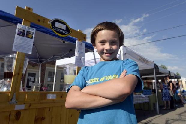 Jack Bonneau stands in front of one of his eponymous lemonade stands at the Erie Farmers' Market in 2015.