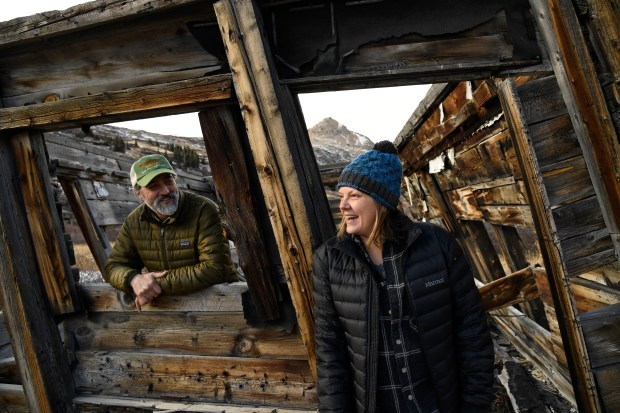 Jeff Crane, who grew up in Denver, left, and longtime partner Kate McCoy, a college professor from upstate New York visit London Mines in November 2016. Joe Harrington's strategy for cleaning up one of the heaviest polluting mines in Colorado includes tourism. The owner of nearly 3,000 acres encompassing Park County's historic London mines is committed to cleaning the zinc-laden water pouring from nearly 70 miles of tunnels beneath the Mosquito Range.
