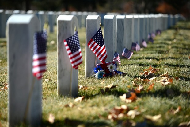 American flags mark the tombstones of the graves of soldiers at Fort Logan Cemetery in Lakewood  on Nov. 11, 2013.