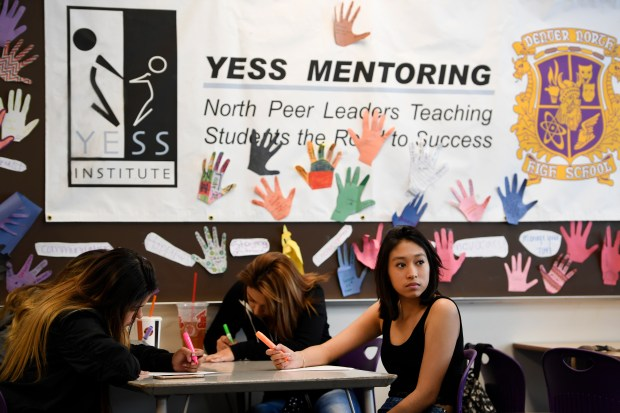 Mentor leader Isme Alvarado, 18, right, listens to program manager Tracie Trinidad, as they take part in YESS Institute class at North High School on Nov. 1 in Denver. YESS Institute's Peer Tutoring Dropout Prevention program trains 11th/12th grade students who are on track to graduate and matches them with underperforming, disengaged 9th/10th grade youth who have low academic scores and are at-risk for school failure. Staff supervisors monitor tutoring sessions, which occur four times a week during the school year, with an intensive focus on school connectedness and study, life and self-advocacy skills. (Photo by Helen H. Richardson/The Denver Post)
