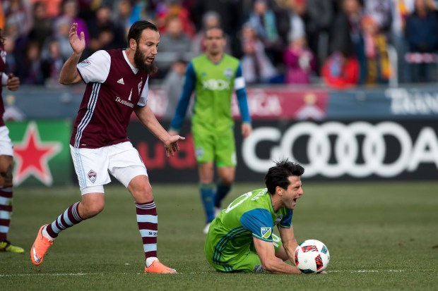 Shkelzen Gashi (11) of the Colorado Rapids reacts as Nicolas Lodeiro (10) of the Seattle Sounders goes down during the first half of the second leg of the Western Conference Finals at Dick's Sporting Goods Park on November 27, 2016, in Commerce City, Colorado.