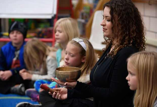 Mindfulness instructor Melissa Kaufmann uses a Tibetan ringing bowl during a 15-minute Creative Challenge Community School's Mindfulness class on Nov. 17, 2016.