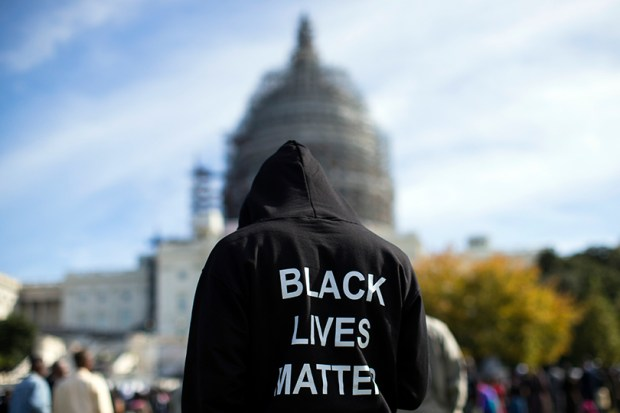 "A man wears a ""Black Lives Matter"" hoodie on the lawn of the U.S. Capitol during an Oct. 10, 2015, rally to mark the 20th anniversary of the Million Man March."