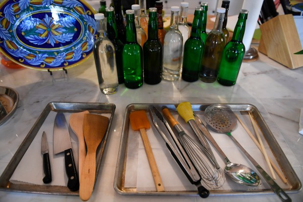 """The """"must-have"""" utensils to use for holiday cooking include from left to right: a paring knife, a chef's knife, wooden and rubber spatulas, thongs, a whisk, a turkey baster, a large spoon for stirring or basting your turkey as well, a skimmer and chinese chopsticks. Local well-known """"foodie"""" Bill St. John helps readers get prepared for the upcoming Thanksgiving Day holiday on October 26, 2016 in Denver."""