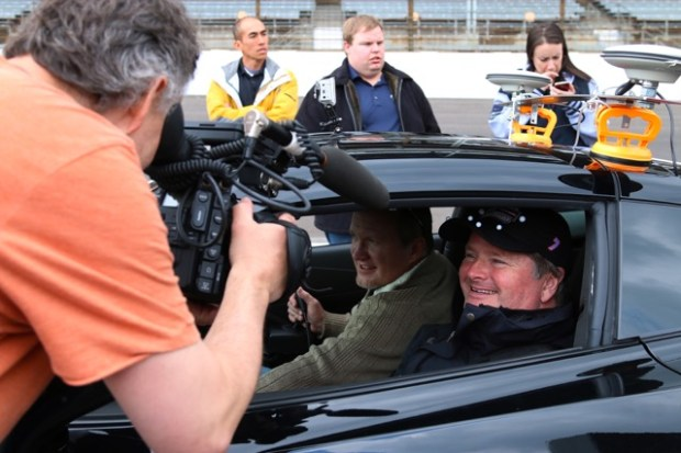 Former IndyCar racer Sam Schmidt behind the wheel of the modified Corvette Stingray that allows a qualified quadriplegic driver to 'drive' the vehicle in racetrack conditions.