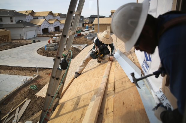 Mexican immigrants work on a housing construction site on May 3, 2013 in Denver, Colorado.
