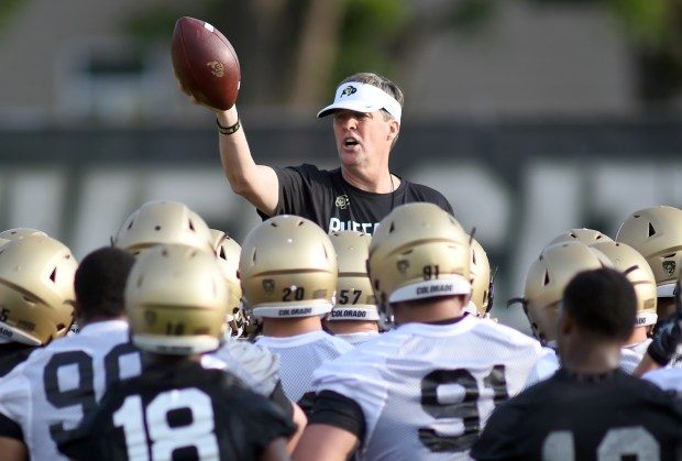 University of Colorado head football coach, Mike MacIntyre addresses the team during football practice, Thursday, Aug. 4, 2016 in Boulder.