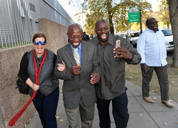 Clarence Moses-EL, middle, walks as a free man with his girlfriend Lauren Gaspar, left, and former cellmate Robert Hawkins on November 14, 2016 in Denver, Colorado. Moses-EL was found not guilty of all charges Monday in the retrial of brutal rape from 29 years ago.