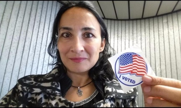 "Asra Nomani poses after casting her ballot. ""I, a 51-year-old, a Muslim, an immigrant woman ""of color,"" am one of those silent voters for Donald Trump."""