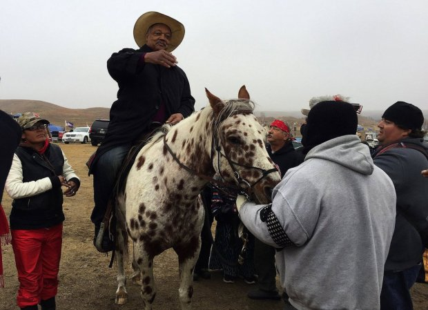 Red Fawn Fallis, left, with Jesse Jackson at the Standing Rock Sioux protest on Oct. 26, 2016.