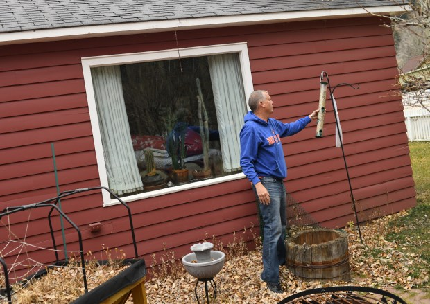 Pete Werlin fills the bird feeder at his mother's house in Georgetown, November 17, 2016. Werlin is looking to make the home a short-term rental to help pay his mother's health care bills after she got sick and moved into a care facility.